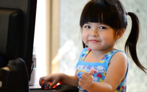 photo of little girl pwning computer programming